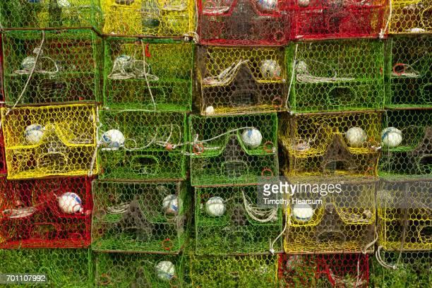 stacks of colorful lobster/crab traps - timothy hearsum stock-fotos und bilder