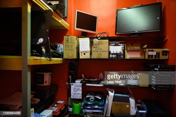 Stacks of computer equipment that have been donated by members of the public are seen in storage areas, ready for testing and possible repair, at the...