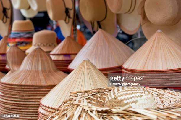 Stacks of conical hats (non la) at market, Vietnam
