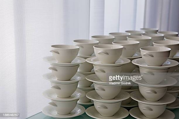 Stacks of cups and saucers