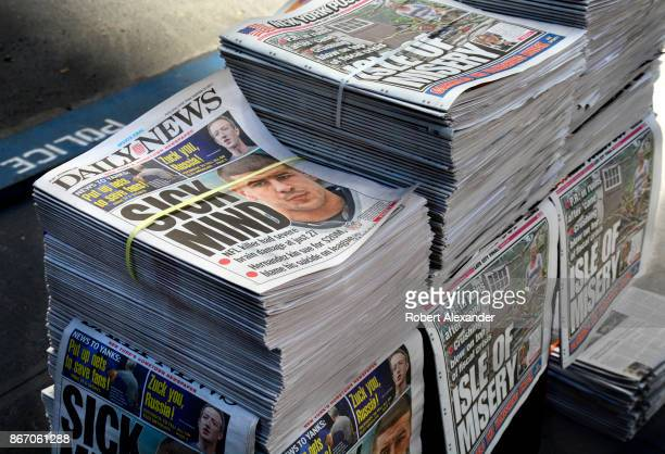 Stacks of Daily News and New York Post tabloid newspapers sit on a sidewalk in New York New York The headline refers to the results of a autopsy on...