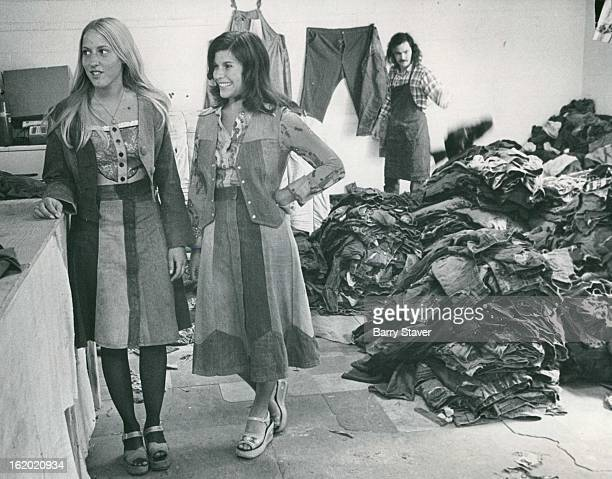JUN 9 1975 JUN 12 1975 Stacks Of Dicarded Jeans add Up To New Fashions For Lovers of old Denim Kathy Wells left models front snap skirt Susie Atlas...