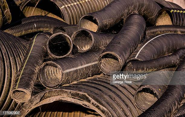 Stacks of discarded plastic irrigation pipes are covered with cobwebs on May 31 near Santa Rosa California Warm summer temperatures and a dry spring...