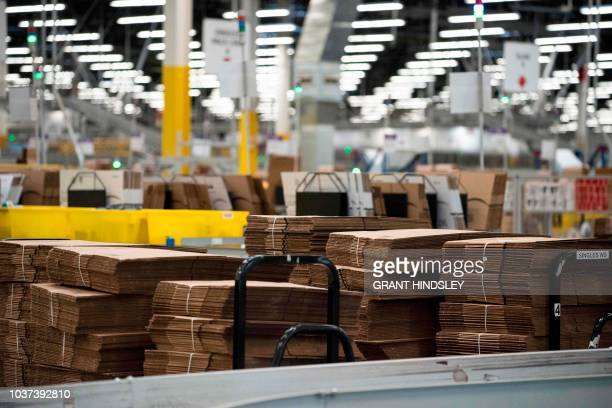 Stacks of empty boxes are seen during a tour of Amazon's Fulfillment Center September 21 2018 in Kent Washington