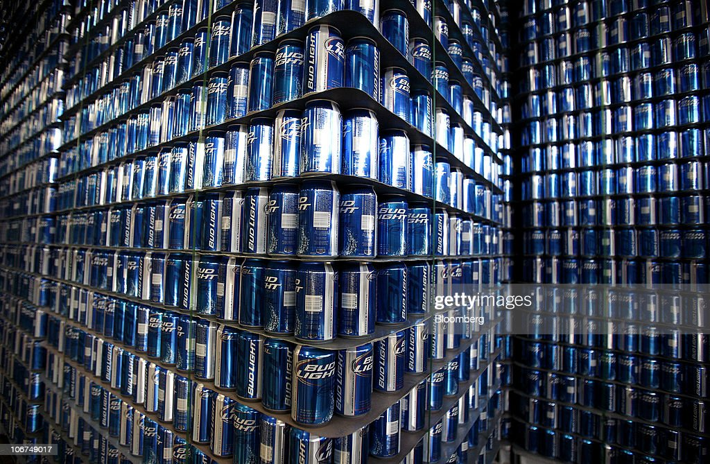 Stacks of empty Bud Light beer cans stand in the empty can