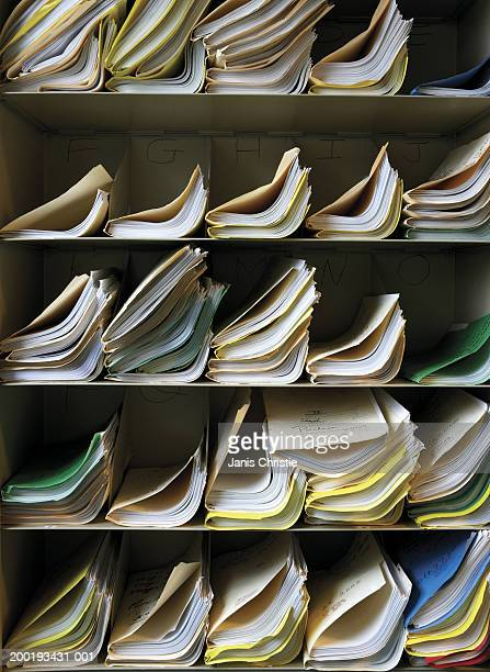 Stacks of files on shelves