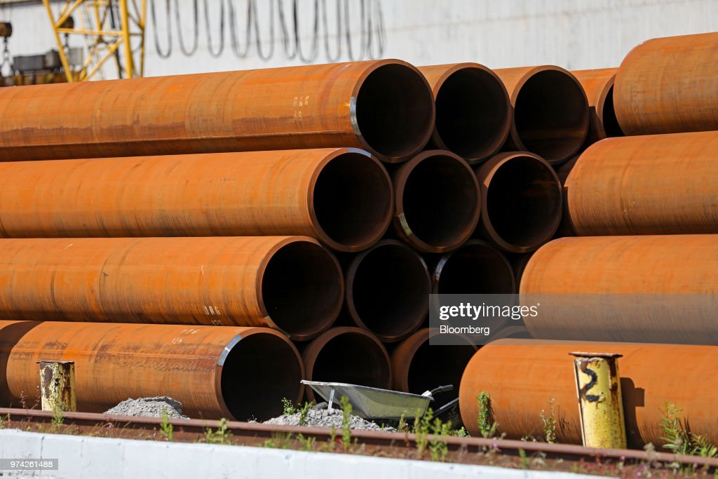 Stacks of finished steel pipes stand in a storage yard at the SAW Pipe Mills, operated by Liberty Commodities Ltd., in Hartlepool, U.K., on Thursday, June 14, 2018. Steel and aluminumtariffsimposed by the U.S. in March may already be filtering through to prices charged by American producers of the metals. Photographer: Chris Ratcliffe/Bloomberg via Getty Images