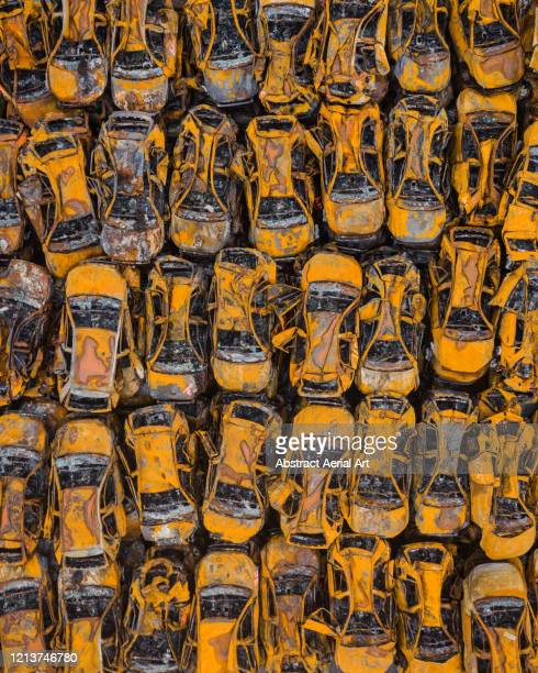 stacks of fire damaged vehicles after an inferno shot from directly above, italy - liguria fotografías e imágenes de stock