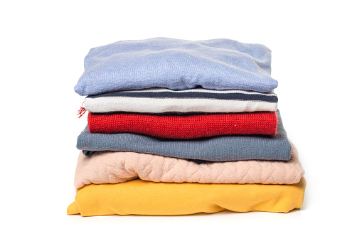 Stacks of folded clothes on white background 1088065988