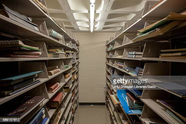 Stacks of folios and books in the bookshelves of Milton S. Eisenhower Library in Johns Hopkins University, 2013. Courtesy Eric Chen. .
