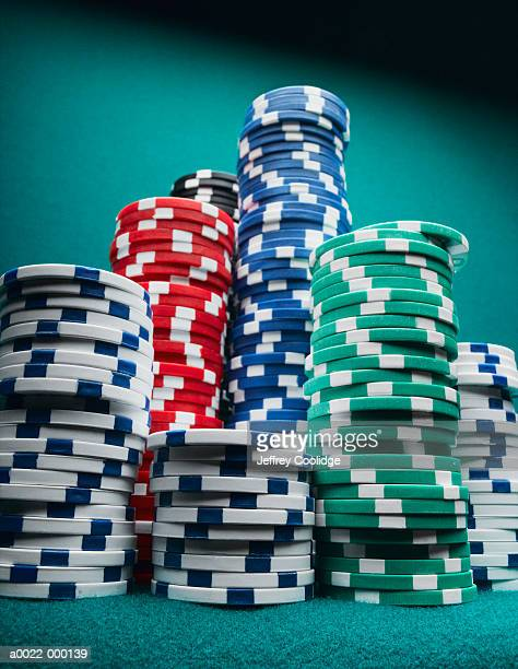 stacks of gambling chips - poker stock-fotos und bilder
