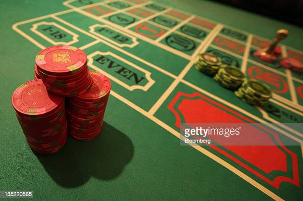 Stacks of gaming chips stand on a roulette table at Casino Venus a mock casino operated by Japan Casino School and Bright Inc to provide the gambling...