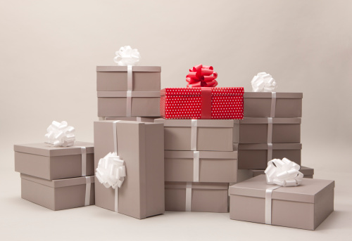 Stacks of gray boxes and one red package with bows - gettyimageskorea
