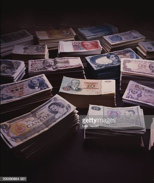 stacks of international currencies - canadian currency stock pictures, royalty-free photos & images