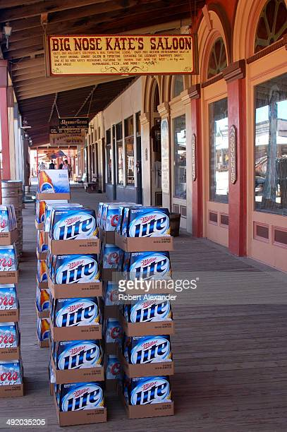 Stacks of Miller Lite beer sites on the board sidewalk in front of Big Nose Kate's Saloon in historic Tombstone Arizona The town featuring staged...
