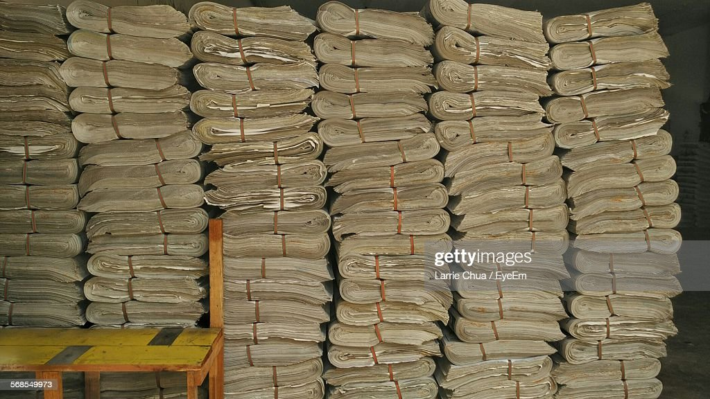 Stacks Of Newspapers By Table : Stock Photo
