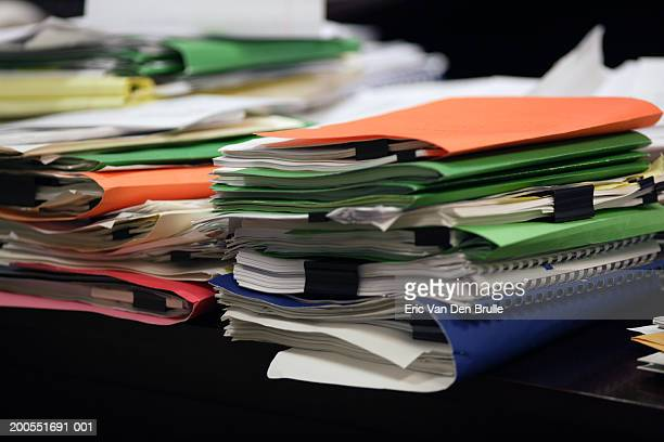 stacks of notepads and organizers on desk, close-up - eric van den brulle imagens e fotografias de stock