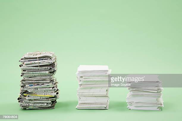 Stacks of paper and newspapers in a row