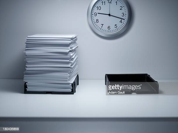 stacks of paper on office desk - to do list stock pictures, royalty-free photos & images