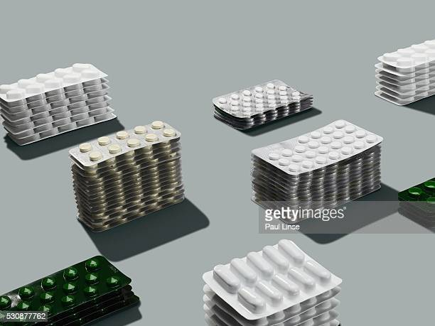 stacks of pills in blister packs - blister pack stock pictures, royalty-free photos & images