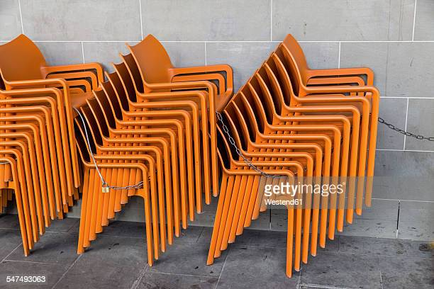 Stacks of plastic chairs of pavement restaurant