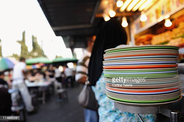 stacks of plastic dishes - plastic plate stock photos and pictures