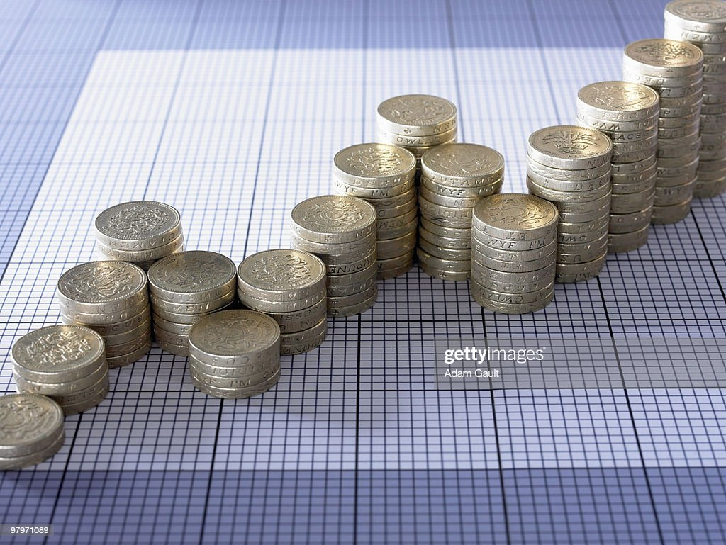 Stacks of pound coins forming ascending graph : Stock Photo