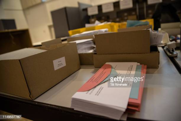 Stacks of prepared absentee ballots waiting to be packed and sent out on May 16 2019 in Berlin Germany Early voting is underway ahead of European...