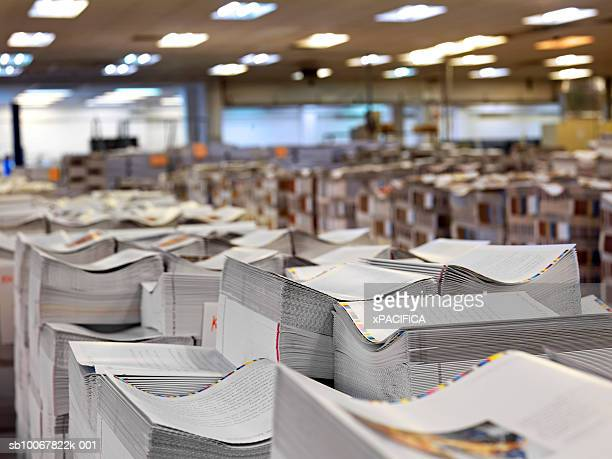 stacks of printed paper at printing press - printing plant stock pictures, royalty-free photos & images