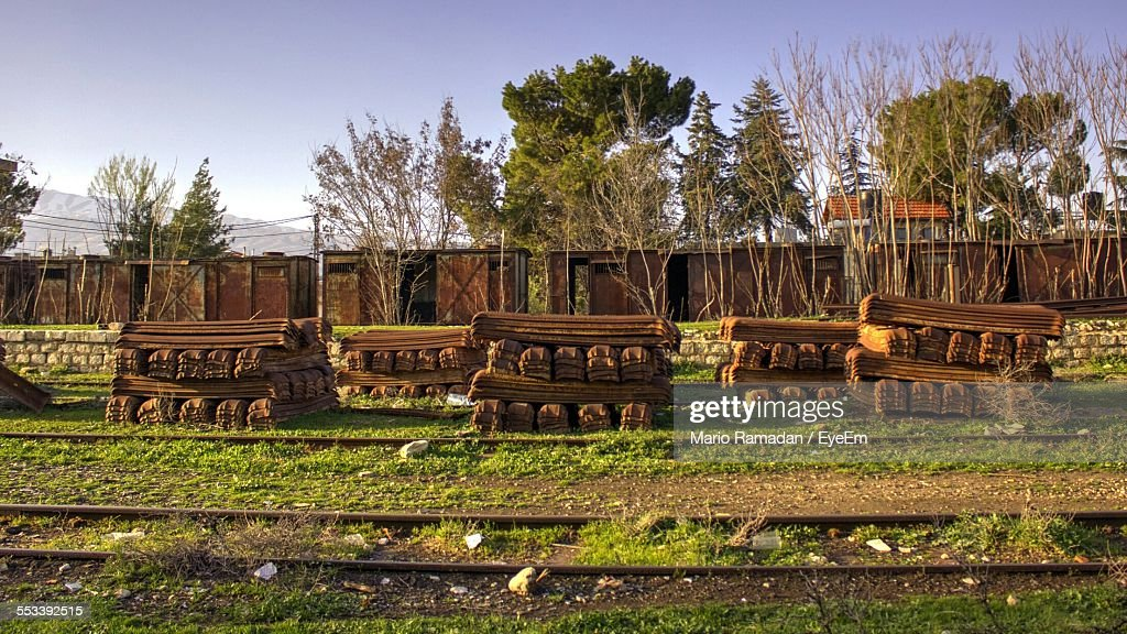 Stacks Of Railroad Ties By Tracks : Stock Photo