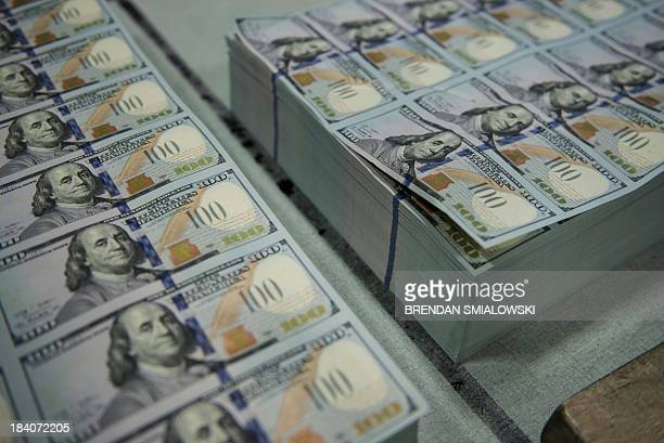 Stacks of rejected new 100 USD bills are seen before being sent for destruction after the mechanical inspection phase of production at the US Bureau...