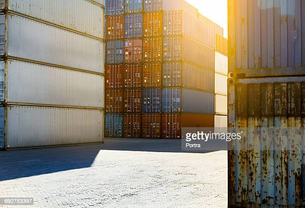 Stacks of shipping containers on sunny day