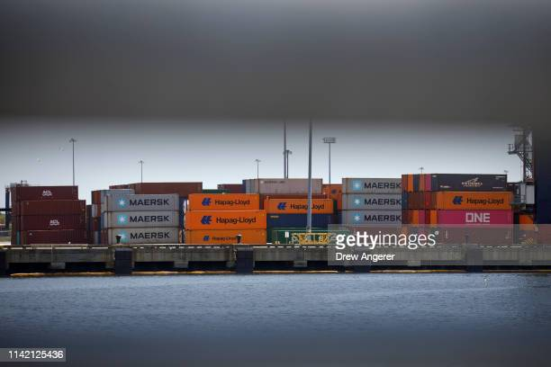 Stacks of shipping containers sit along the dock at the New York Container Terminal in Staten Island as seen from Elizabeth, New Jersey, May 7, 2019....