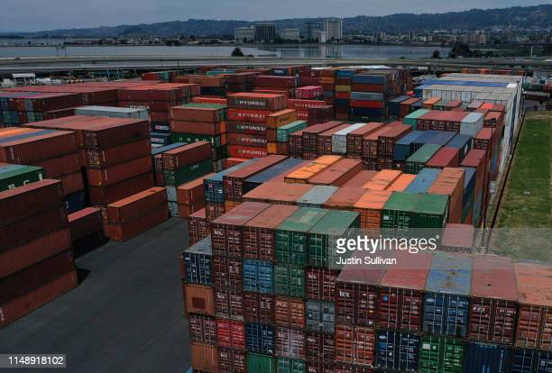 Stacks of shipping containers sit in a storage area at the Port of Oakland on May 13 2019 in Oakland California China retaliated to US President...