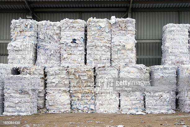 CONTENT] Stacks of shredded paper waiting to be recycled at recycling facility
