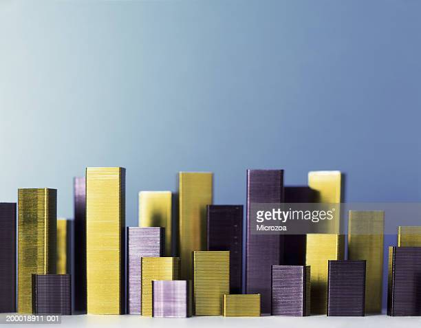 stacks of staples forming cityscape - microzoa stock pictures, royalty-free photos & images