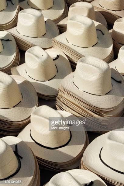 stacks of straw hats - country musik stock-fotos und bilder