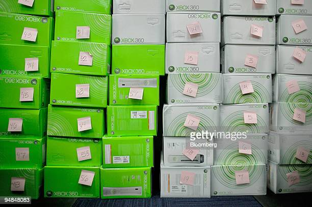 Stacks of the new Microsoft Xbox 360 video-game console are tagged with reservation numbers at a Best Buy store in New York, NY late Monday, November...