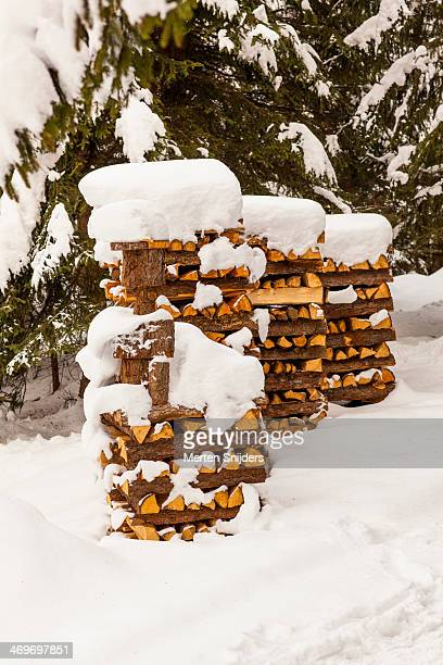 Stacks of timber with snow cover