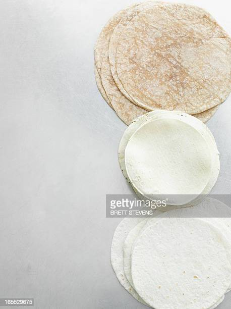 stacks of tortillas on counter - tortilla flatbread stock pictures, royalty-free photos & images