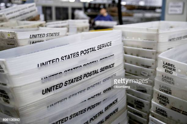Stacks of United States Postal Service flat tubs sit at the USPS Suburban processing and distribution center in Gaithersburg Maryland US on Tuesday...