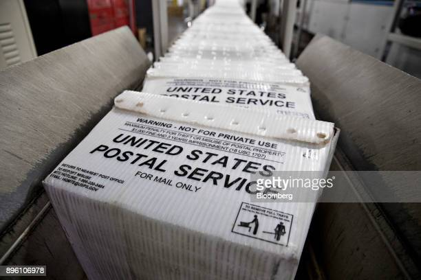 Stacks of United States Postal Service flat tubs sit on a conveyor belt at the USPS Suburban processing and distribution center in Gaithersburg...