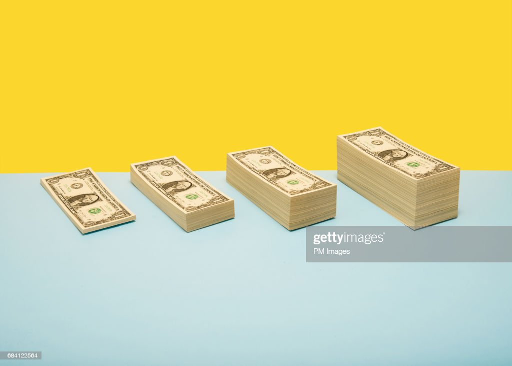 Stacks of US 1 dollar bills in ascending order : Stock Photo