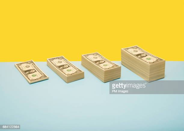 stacks of us 1 dollar bills in ascending order - savings stock pictures, royalty-free photos & images