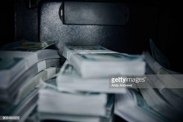 POV Stacks of US dollars in a safe