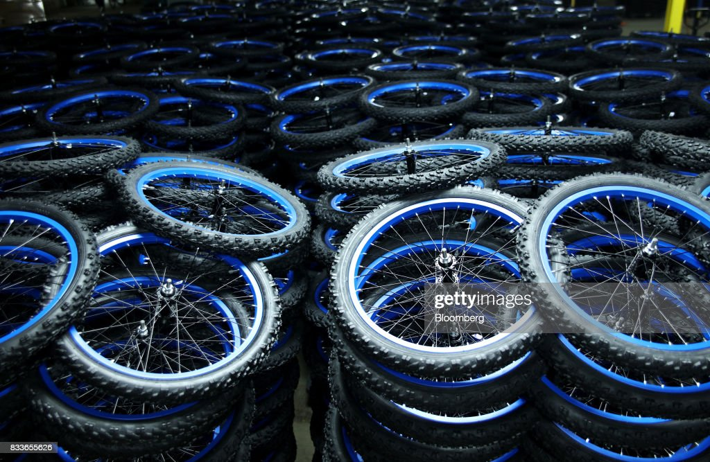 Stacks of wheels for the Boys MT20 model bicycle sit at The Kent International Inc. Bicycle Corporation of America brand Assembly facility in Manning, South Carolina, U.S., on Sunday, June 25, 2017. Almost all of the roughly 18 million bicycles sold each year in the U.S. come from China and Taiwan. This year, about 130 workers at the Bicycle Corporation of America's new factory will assemble 350,000 bikes in the U.S. Photographer: Travis Dove/Bloomberg via Getty Images