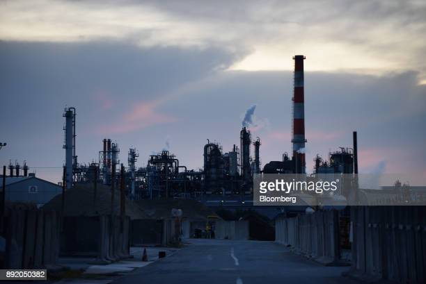 Stacks stand at a plant at dusk in the Keihin industrial area of Kawasaki Kanagawa Prefecture Japan on Tuesday Dec 12 2017 The Bank of Japan will...