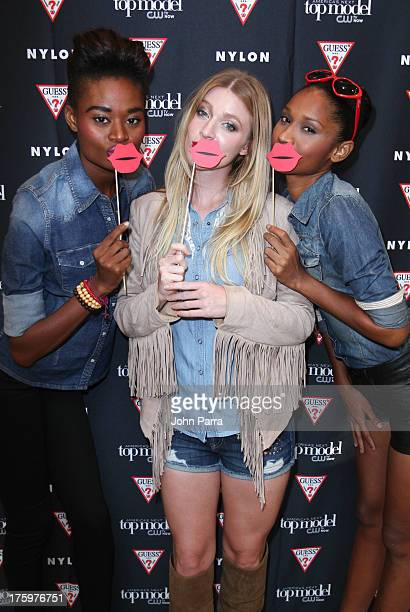 Stacy Ann Laura Kirkpatrick and Renne Bhagwandeen attend the GUESS America's Next Top Model event at GUESS Lincoln Road on August 10 2013 in Miami...