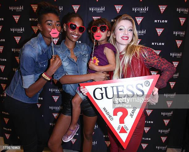 Stacy Ann Renee Bhagwandeen guest and Laura Kirkpatrick attend the GUESS America's Next Top Model event at GUESS Lincoln Road on August 10 2013 in...