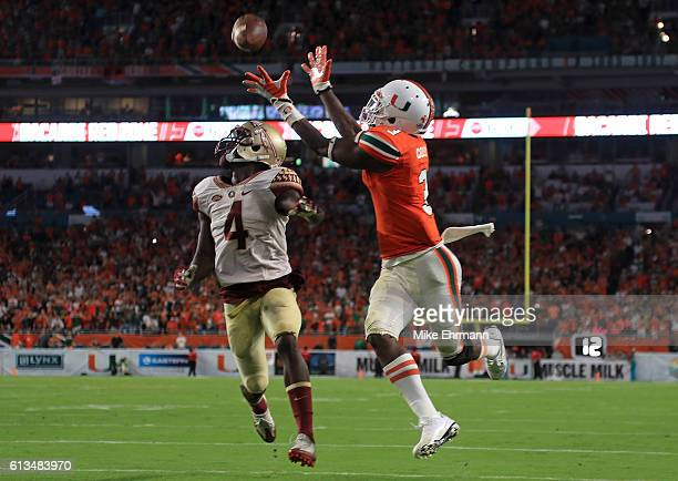 Stacy Coley of the Miami Hurricanes catches a touchdown over Tarvarus McFadden of the Florida State Seminoles during a game at Hard Rock Stadium on...